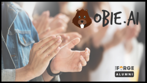 Obie logo and clapping for award